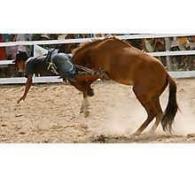 Flying rodeo cowboy thrown over the top Photographic Print