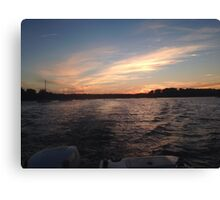 Sunsets over the water Canvas Print