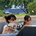 Reading in an Outdoor Cafe by Kathleen Brant