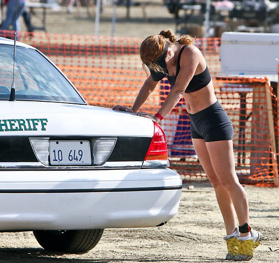 Jogging - A Woman and the Sheriffs Car by Buckwhite