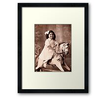 Girl on a rocking horse  Framed Print