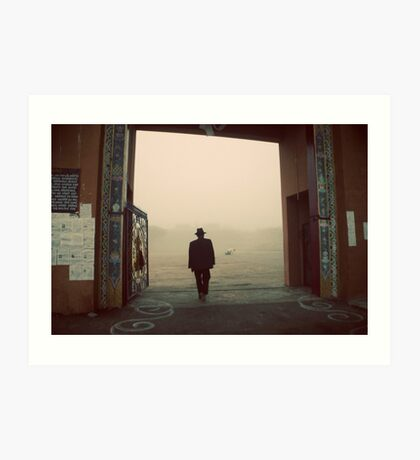 Silhouette of a man at a monastery Art Print