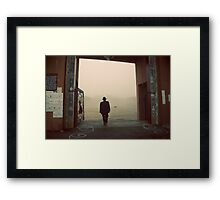 Silhouette of a man at a monastery Framed Print