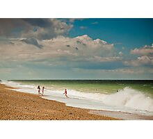 Fun in the sea at Cley Photographic Print