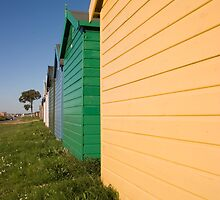 Colourful beach huts in Calshot, Solent, Hampshire, UK by Ian Middleton