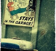 WHAT HAPPENS IN THE GARAGE . . .  by James L. Brown