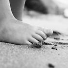 Barefoot on Beach- child's feet on sandy beach by homemadeinchina