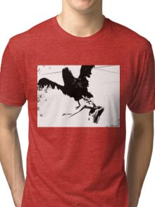 Giant Monsterbird Continues his Nefarious Journey Tri-blend T-Shirt