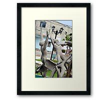 Fountain men Framed Print