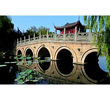 Rainbow Bridge over Lotus-shaded Water  Photographic Print
