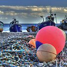 Boats on the beach by Rob Hawkins