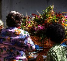 Thai villagers offering flowers and incense by fabianfred