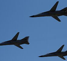 F-111 Formation Fly by by Daniel McIntosh