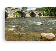 The flowing waters and the bridge Canvas Print