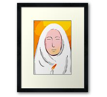 nun praying in candle light. Framed Print