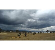 Storm clouds gathering over a paddock along the Hume Highway Photographic Print