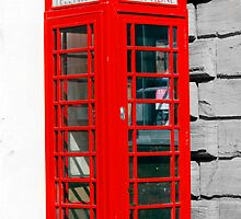 Single red phone box in London by chris-csfotobiz