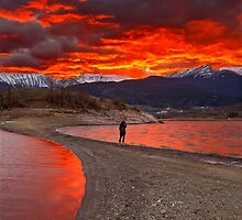 Fire in the sky - Lake Plastiras by Hercules Milas