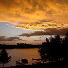 Rainy Lake Sunset by John Callan