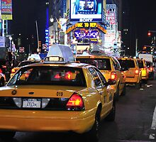 Taxis in Time Square by Margaret Whyte