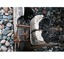 Rusty sea worn wood and pebbles Photographic Print
