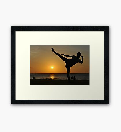 Roundhouse Kick Infront of A Sunset-Darwin Framed Print