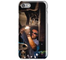 Mechanic soldering a muffler iPhone Case/Skin