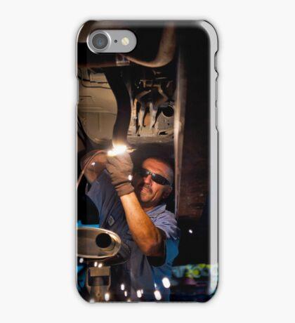 Mechanic soldering a muffler iPhone Case/Skin