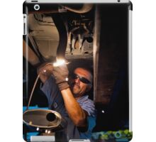 Mechanic soldering a muffler iPad Case/Skin