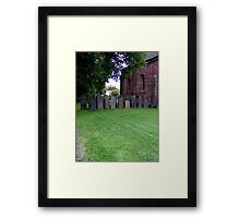 Sheltered grave stones Framed Print