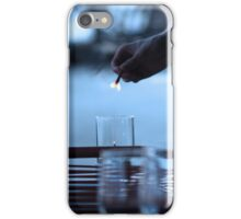 Waiter lighting candles in a restaurant iPhone Case/Skin