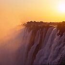 Sunset over the Victoria Falls, Zambia by Alex Cassels