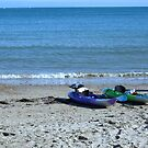 Canoes on the beach - Swanage Bay Dorset by viennablue