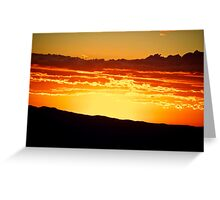 Setting sun across the valley Greeting Card