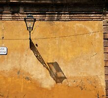 Lamp, shadow and street sign, Luca, Italy by Catherine Ames