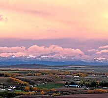 Sunrise Okotoks  by Judy Grant