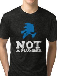 Not a plumber. Tri-blend T-Shirt