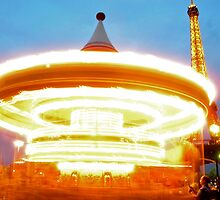 Eiffel Tower and  merry-go-round by Gustavo Bernal