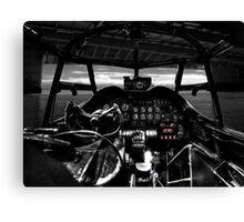 Lancaster bomber cockpit looking out through hangar Canvas Print