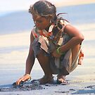 Indian Gypsy Girl collecting sea shells. by joshuatree2