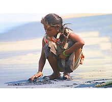 Indian Gypsy Girl collecting sea shells. Photographic Print