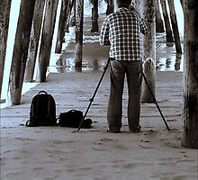 The Photographer Under The Pier by paintingsheep