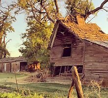 Rustic abandoned red barn at sunset by JULIENICOLEWEBB