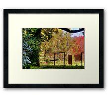 Swinging into Autumn Framed Print
