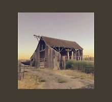Rustic collapsing barn at sunset T-Shirt