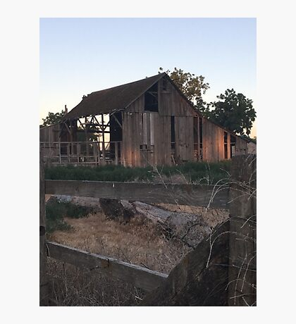 Distressed wooden barn watching the sun go down  Photographic Print