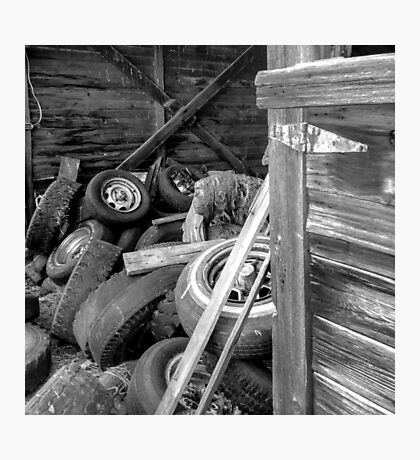 Tires thrown in a barn  Photographic Print