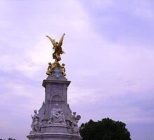 Golden statue - Buckingham Palace London by Naomi Seville