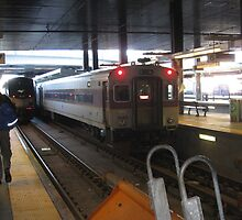 Amtrak Regional and MBTA Commuter Rail together at North Station by Eric Sanford