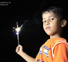 A boy celebrating by Syed Rizwan Ali
